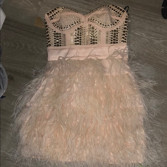 bebe Dresses & Skirts - Pink nude mini dress with studs and feathers